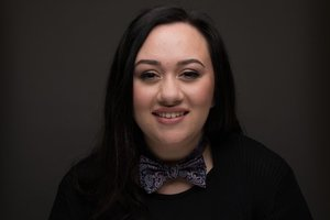 Allie Higgins-Pompu's Headshot from How to Succeed in Business Without Really Trying