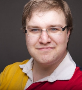 Tim Vollhoffer's Headshot from The 25th Annual Putnam County Spelling Bee