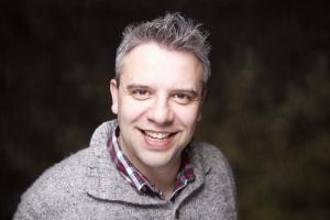 JP Thibodeau's Headshot from Urinetown