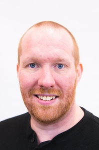 Jason Johnson's Headshot from Evita
