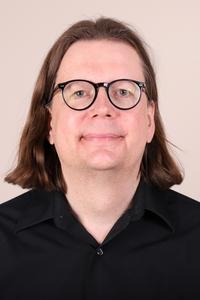Kevin DeBacker's Headshot from Avenue Q