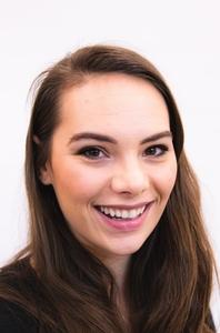 Alina Cox's Headshot from Evita
